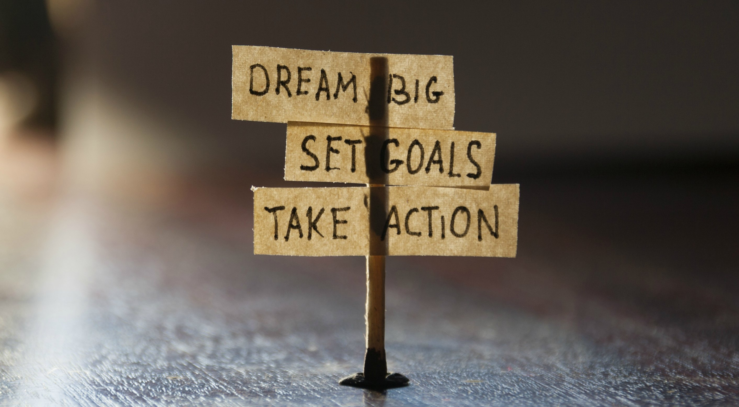 Dream Big, Set Goals, Take Action, concept, tags on the table.