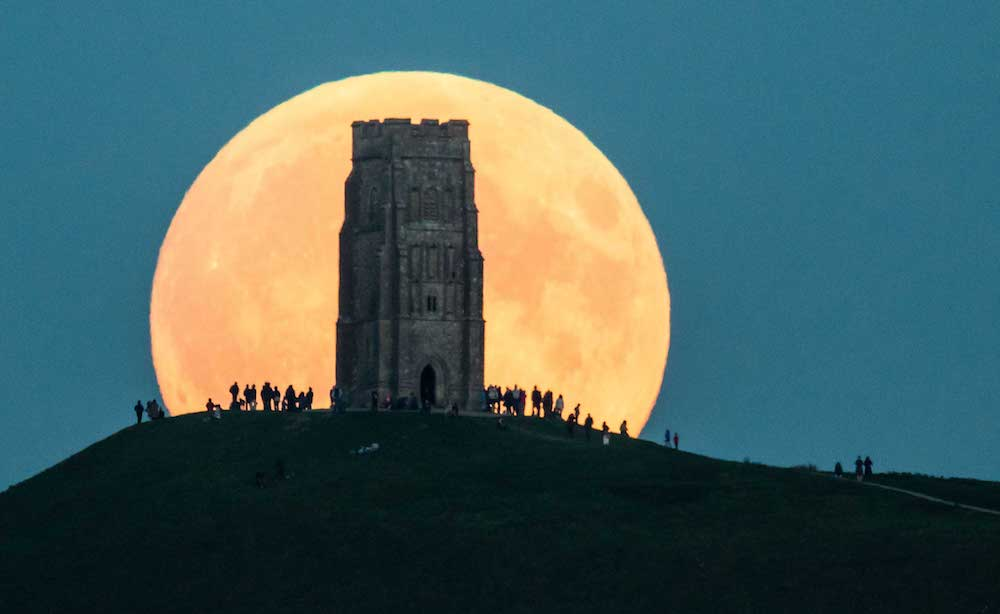 GLASTONBURY, UNITED KINGDOM - SEPTEMBER 27:  The supermoon rises behind Glastonbury Tor on September 27, 2015 in Glastonbury, England. Tonight's supermoon, so called because it is the closet full moon to the Earth this year, is particularly rare as it coincides with a lunar eclipse, a combination that has not happened since 1982 and won't happen again until 2033.  (Photo by Matt Cardy/Getty Images)